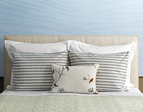 pillows on a bed lined up