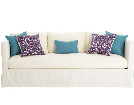 White Sofa With Turquoise And Purple Pillows