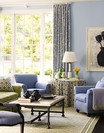 Blue Club Chairs In The Family Room Or Living Room With Patterned Curtains And Painting Of