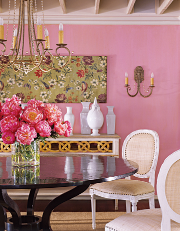 Pink Dining Room With Flowers On Table