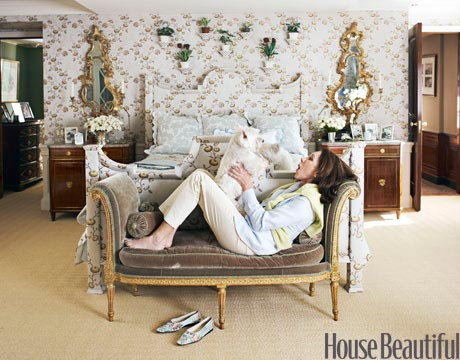 Woman Lying On Daybed With Dog In Front Of Her Bed