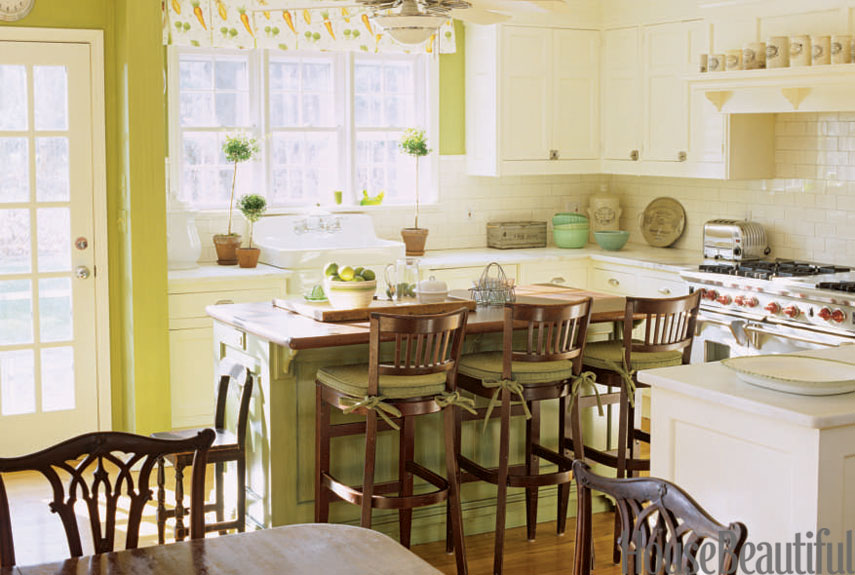 Green Kitchen With Wood Stools