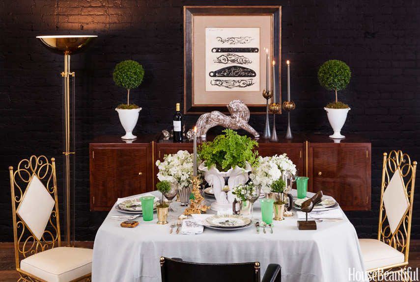 """Charleston-based event planner Tara Guérard has a passion for vintage. With pieces from her curated collection on 1stdibs, she is spreading the love in this tablescape she designed. """"If everything is vintage, it looks like a jumble,"""" she says. """"Layering in contemporary elements keeps things clean, and then the special pieces can really stand out."""" Shop a similar look:green glasses ($37, jossandmain.com), oversized white vase ($95, jossandmain.com),pale blue tablecloth ($37, jossandmain.com)"""