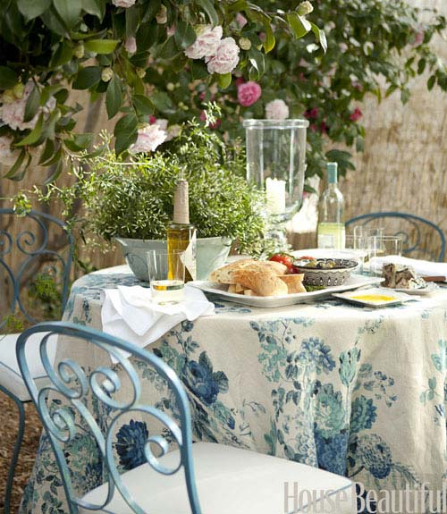 outdoor dining table with vintage french chairs - Cottage Decorating