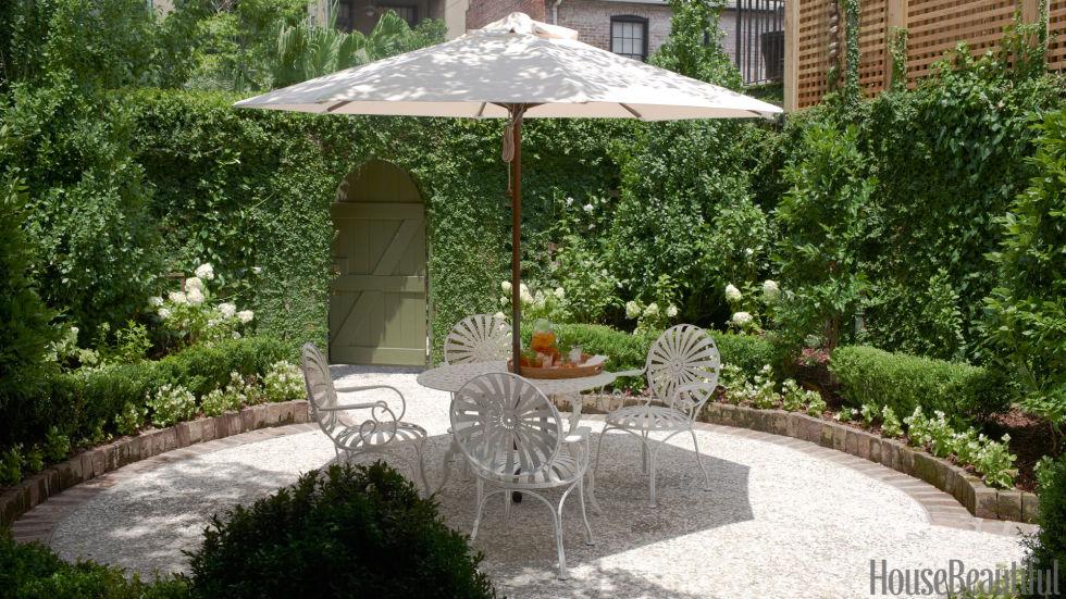 Tucked into the backyard of a Savannah row house, the walled courtyard garden is a fragrant oasis lush with jasmine, hydrangeas, orange trees, and creeping fig. Antique bricks and boxwood define the form, and crushed oyster shells cover the ground.<br />
