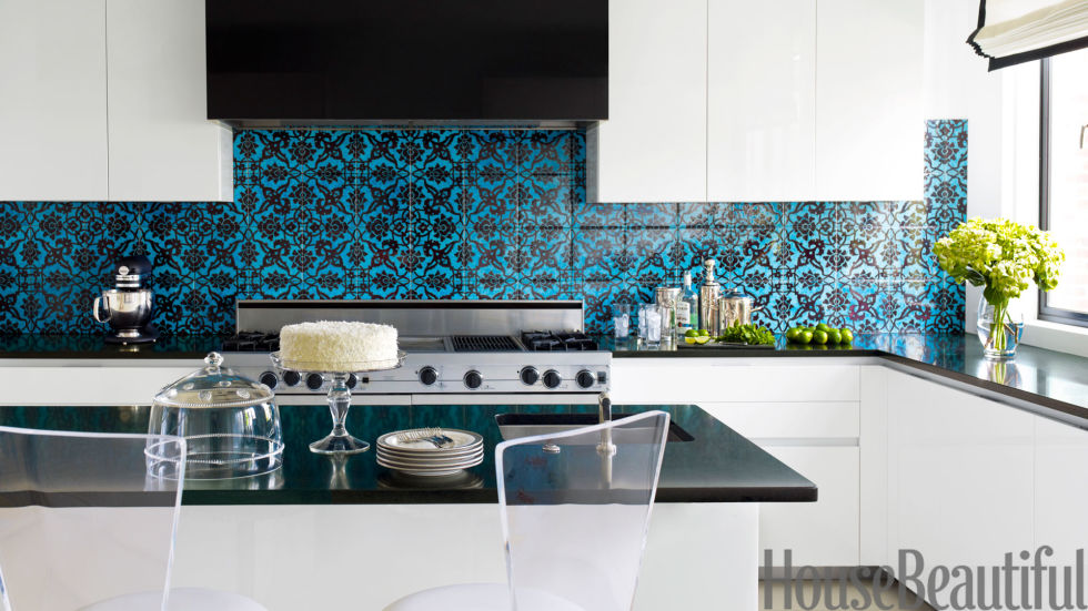 Designers Jeff Lincoln and Hillary Thomas designed the kitchen in a Washington, D.C. town house as a contemporary counterpoint to the rest of the home, which has a '40s French feel. They injected a jolt of color and graphics with a Turkish patterned tile from Ann Sacks and Absolute Black granite countertops.