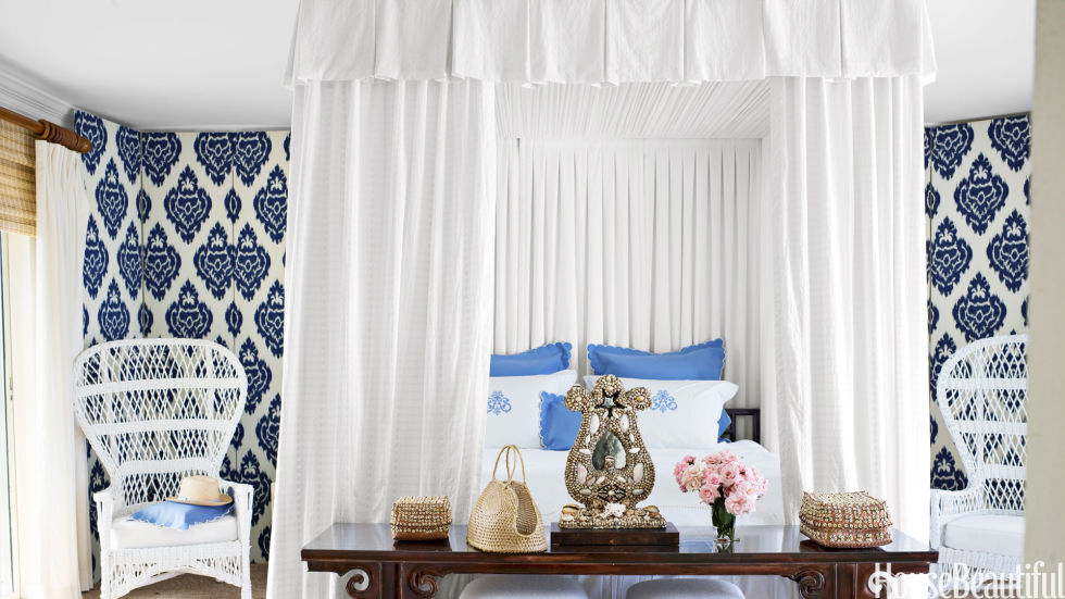 "Ikat screens add graphic interest to Amanda Lindroth's Bahamas bedroom with a dreamy eyelet canopy. ""To give the room some architecture, I raised the canopy to the ceiling,"" Lindroth says. ""It's just white 1960s eyelet."""