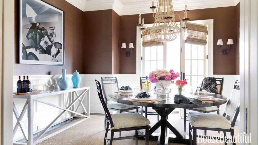 """If you love rich browns in your decor, you """"take your obligations seriously, are industrious, and value the respect of those close to you,"""" Smith says. Chocolaty brown grass cloth — Sisal in Sable from Clarence House — adds intimacy in the dining room of an Old Greenwich, Connecticut, house designed by Lee Ann Thornton."""