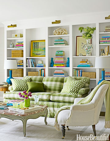 "The cozy upstairs library in a Lattingtown, New York, house, was formerly a bedroom, ""and we wanted to give a sense of purpose,"" designer Meg Braff says. The sofa fabric is Laura Ashley's Springfield 22, through Kravet."