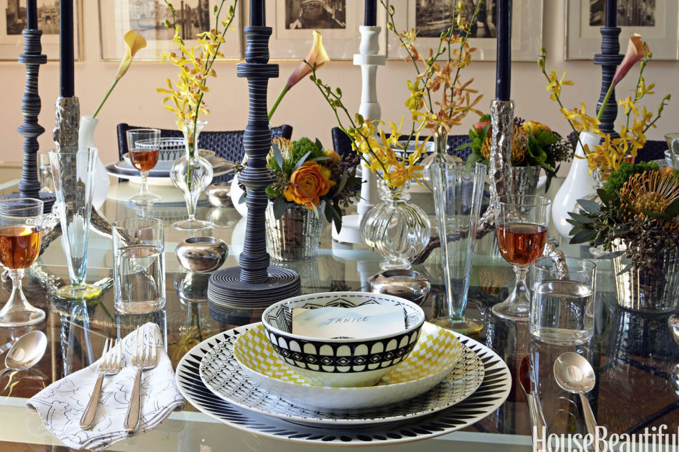 """Don't limit flowers to the middle of the table.Give each guest their own arrangement likeJanice Feldman's Thanksgiving set-up. """"I do lots of single-bud bouquets, placed so you see the person sitting opposite you – so important,"""" says the founder of Janus et Cie. Shop a similar look: tall candle holders ($89, amazon.com), green place setting ($79, jossandmain.com), yellow buds ($180, wayfair.com)"""