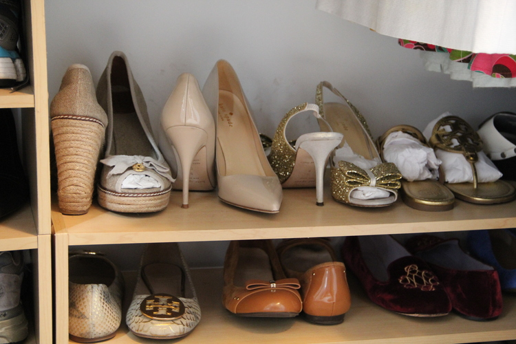 You can fit more on your closet shelves if you storeshoes with the right and left ones facing opposite directions — genius! To do this, face one shoe toe to thefront and the other heel to thefront. See more at Redefining Domestics »