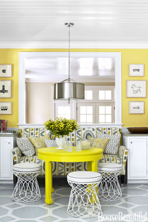 "Sunny rooms are trending again. ""Yellows, from pale butters to dark mustard, are cropping up everywhere,"" says Stephanie Piece, MasterBrand Cabinets' director of design and trends. Carry it from the walls to the furniture, like this  suburban kitchen by Lindsey Coral Harper.  Get this paint color: Benjamin Moore Inner Glow 348"