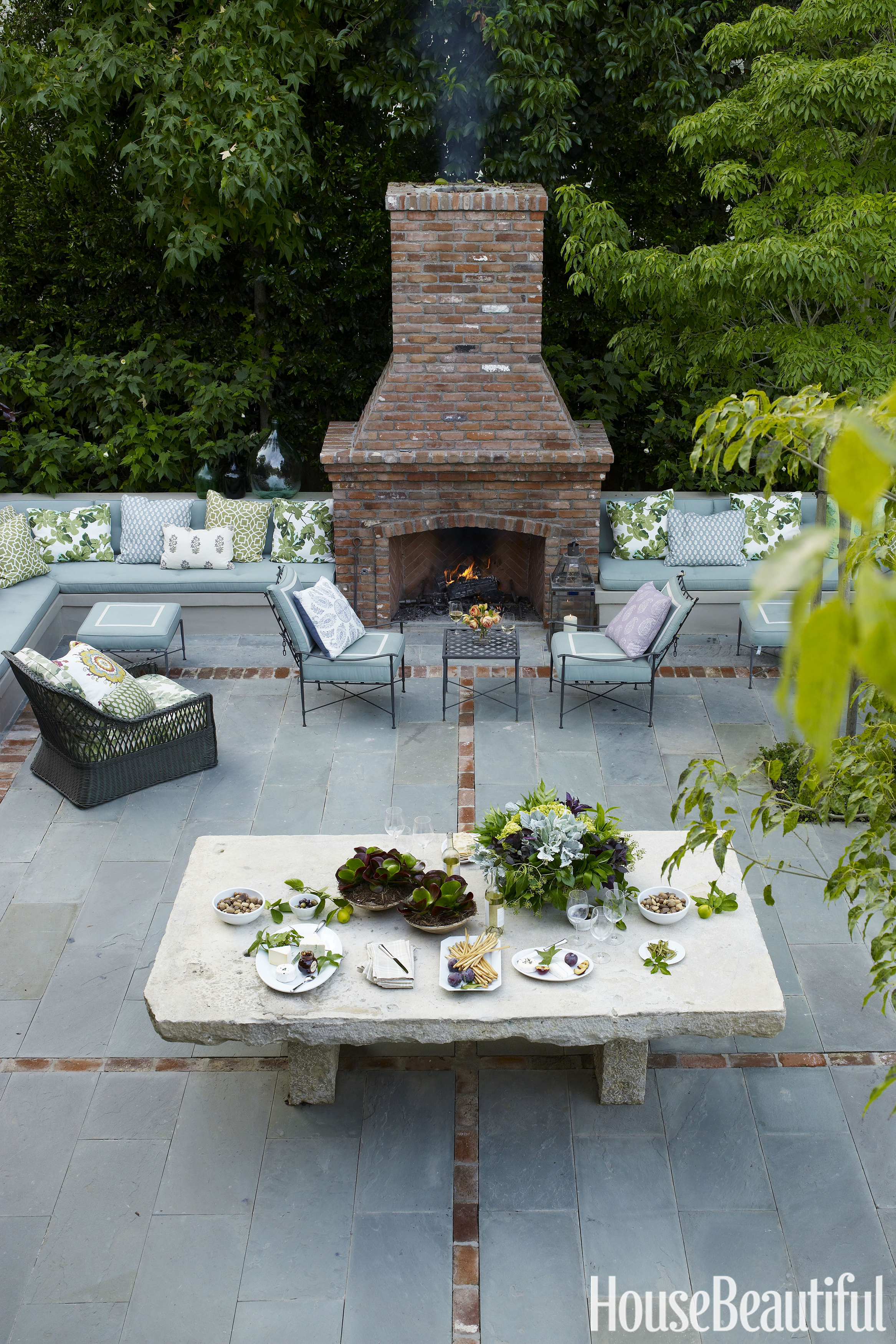 20 Outdoor Fireplaces That Will Keep You Warm All Night ... on Brick Outdoor Fireplace Ideas id=47909