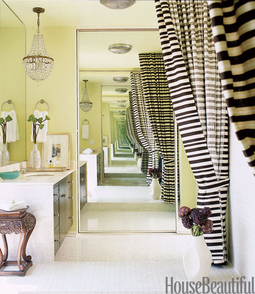 Bath With Striped Curtains And Green Walls