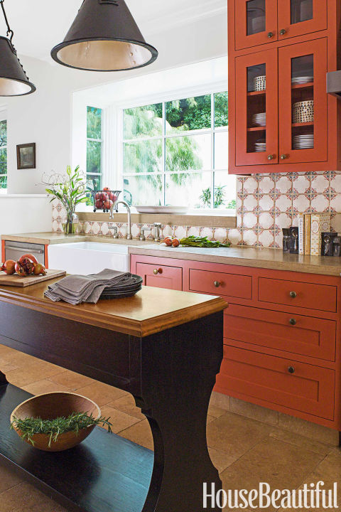 "Pantone named ""Autumn Maple"" as one of its top shades for (surprise, surprise) autumn, but the fall hue looks fresh year-round. A similar burnt orange spices up this kitchen by Melanie Coddington.  Get this paint color: Benjamin Moore Salsa Dancing"